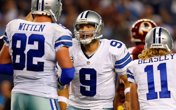 Jason Witten Photos - Tony Romo #9 of the Dallas Cowboys talks to Jason Witten #82 of the Dallas Cowboys  during the second half against the Washington Redskins at AT&T Stadium on October 27, 2014 in Arlington, Texas. - Washington Redskins v Dallas Cowboys