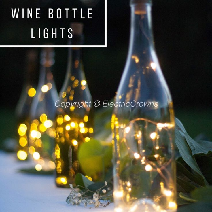 Wine Bottle Centerpieces for Weddings, Wine Bottle Decor, Wine Theme, Fairy Lights, Wedding Centerpiece, Battery Operated Wine Bottle Lights by ElectricCrowns on Etsy https://www.etsy.com/listing/472892410/wine-bottle-centerpieces-for-weddings
