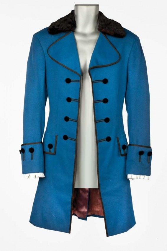 """Tyrone Power """"Count Axel de Fersen"""" coat and two vests by Gile Steele for Marie Antoinette. (MGM, 1938) Royal blue wool period long coat with black velvet buttons and fur collar. MGM label handwritten """"Tyrone Power 1-1030-9869."""" Ivory cotton dickie with lace trim handwritten """"T. POWER M. ANTOINETTE."""" Worn by Tyrone Power as """"Count Axel de Fersen"""" when he first meets the Queen at the gambling house in Marie Antoinette."""