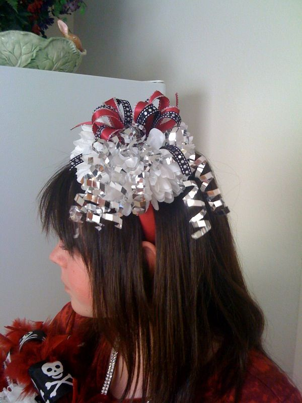 Attach mum to a headband then embellish with ribbons and extras. You can make more streamers down the back too.