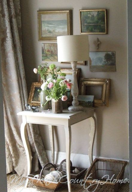 beautiful French paintings in the entrance hall ~ via My French Country Home