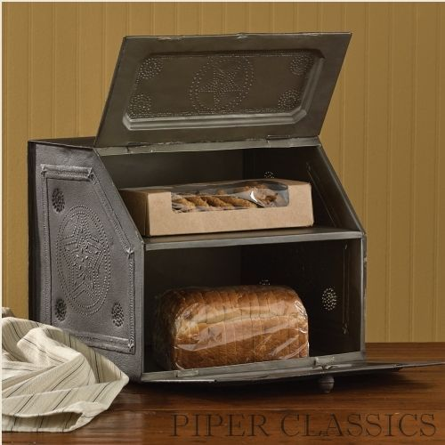 Replica of a vintage bread box, this Black Star Metal Bread Box is updated with embossed details and a rustic black finish. Not just for the kitchen, it can also double as a desk organizer! #countryhomedecor #homedecor