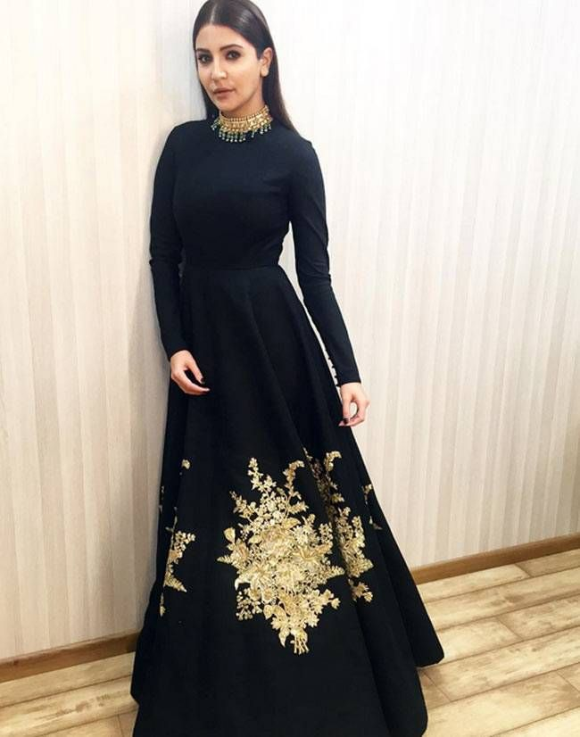 Anushka Sharma in a black and gold Sabyasachi number.