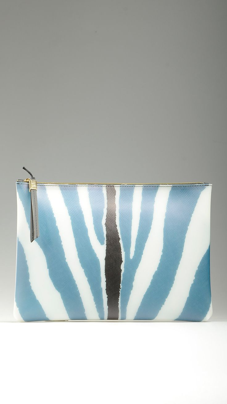 Zebra printed pvc clutch bag in blue and black tones featuring top zip, golden hardware, 13.3'' x 1.1'' x 9'', L size, 100% pvc.
