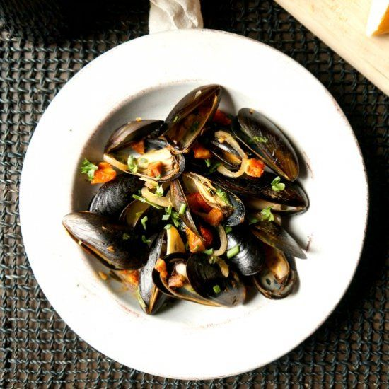 mussels in a white wine broth with sun-dried tomatoes and chorizo ...