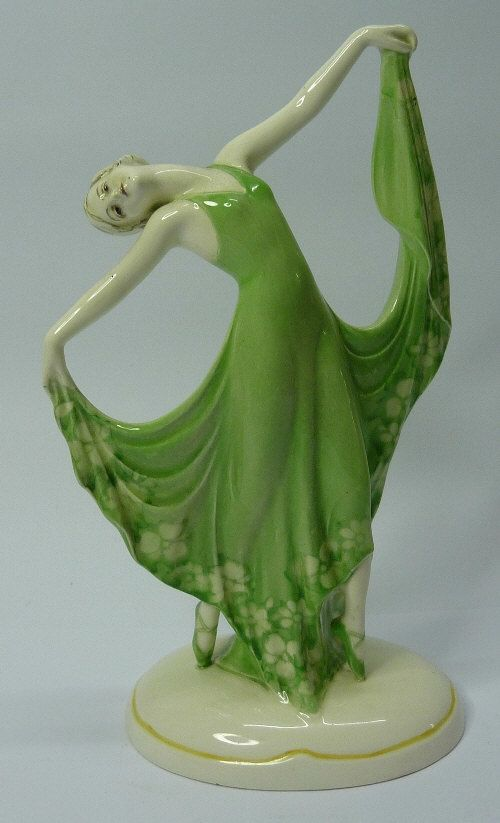 A continental Art Deco figure of a lady, height 21cms  Sold For: £95