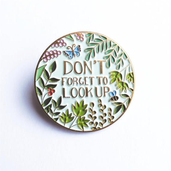 Remember to look up when you wear this cute soft enamel pin. Measures approx 2.9 cm x 2.9 cm.