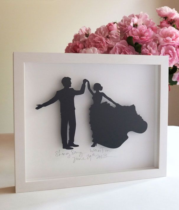 Shing Song and Wan Tin. 3mm laser cut black silhouettes. White mount, names/wedding date hand written. Custom hand made frame in white. 250mm high x 300mm wide x 30mm deep.