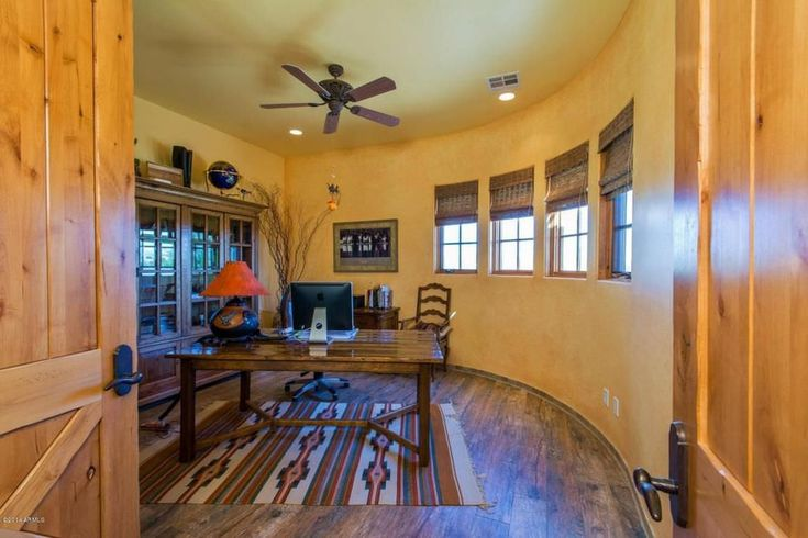 Light yellow color ceiling with dark brown color hanging, flush recess lights, rustic light orange color on the wall, dark brown window cover, same color with the cabinet, table, chair & then a rustic brown hardwood floor.
