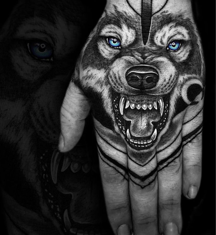 angry wolf tattoo on the hand