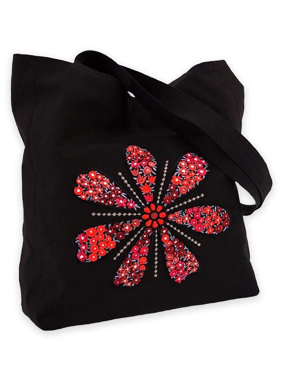 Bag of black synthetic fabric with present-day embroidery