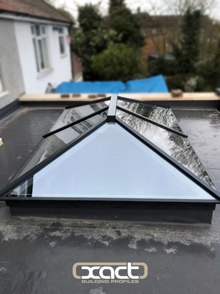 One of two XACT Aluminium Roof Lanterns installed on a single storey rear extension in Grays, Essex. Roof lanterns are a perfect way to bring natural light back into the home when doing a ground floor extension as the light reflects of the different angles of the lantern.