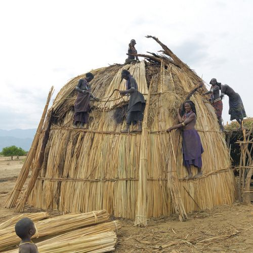 Africa |  Sights and Sounds.  Erbore women building a new house - Ethiopia