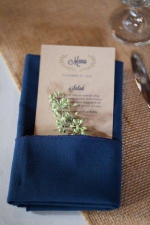 I like the look of Kraft paper or ivory background with navy font since my napkins will be navy also. Touch of gold font or graphic makes it pop
