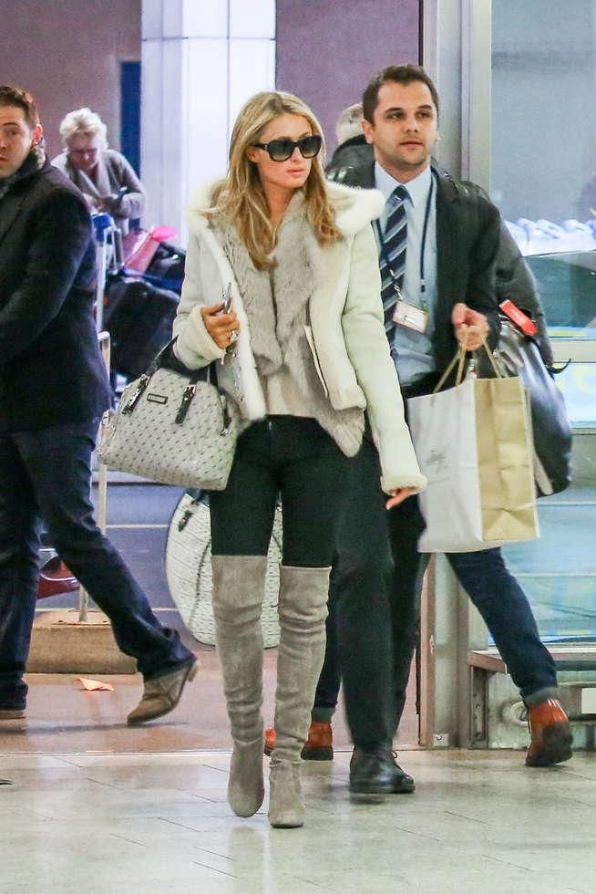 Paris Hilton wearing Stuart Weitzman Suede Highland Boots in Topo and Yves Salomon Grey Vest Fur