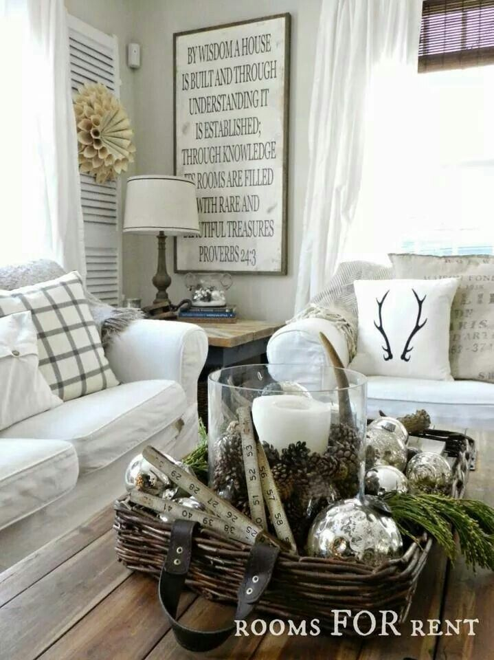 I love this classic look with white seasonal decor and evergreen accents!