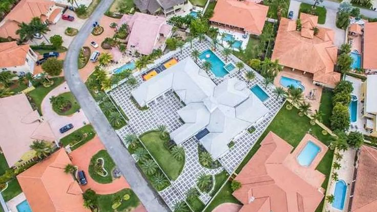 """It would appear Flo Rida purchased the Miami home of his producer Elric """"E-Class"""" Prince, with the Hialeah estate including a Miami Heat-themed basketball court outside."""