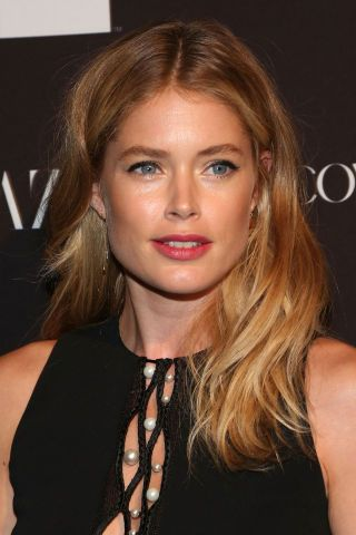 Doutzen Kroes's ear tuck is a great go-to for a medium length style in a pinch. Preferably styled with Doutzen's signature blonde hair.