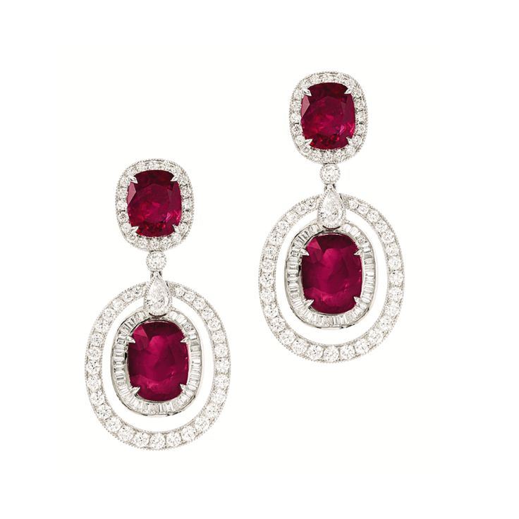 PAIR OF RUBY AND DIAMOND PENDENT EARRINGS Each suspending on a cushion-shaped ruby, to a double-frame set with brilliant-cut diamonds, surmounted by a cushion-shaped ruby surrounded by brilliant-cut diamonds, the rubies and diamonds altogether weighing 12.78 and 2.30 carats respectively, mounted in 18 karat white gold.