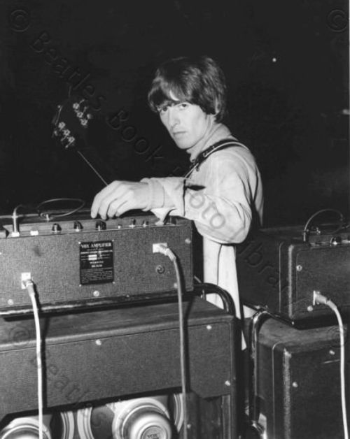 "George Harrison at rehearsals for Another Beatles Christmas Show, Hammersmith Odeon, London, 21 December 1964.Photos: The Beatles Book""Hello. I'd like to send a request to somebody who I used to go to school with too, and he used to play bass in the group: Paul McCartney. (Laughter) And if yer listening, Paul, at work, it was great going to school with you and we had a nice time, and I'd like to play a nice one called 'Love Me Do.'"" - George Harrison in an interview with Chris De..."