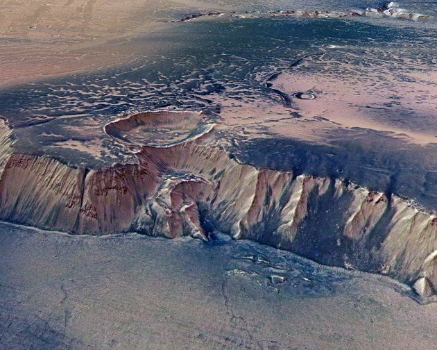 A cliff, up to 4,000 m high, located in the eastern part of Echus Chasma, one of the largest water source regions on Mars, is seen in this image taken by the High-Resolution Stereo Camera (HRSC) on board ESAís Mars Express and made available July 14, 2008.