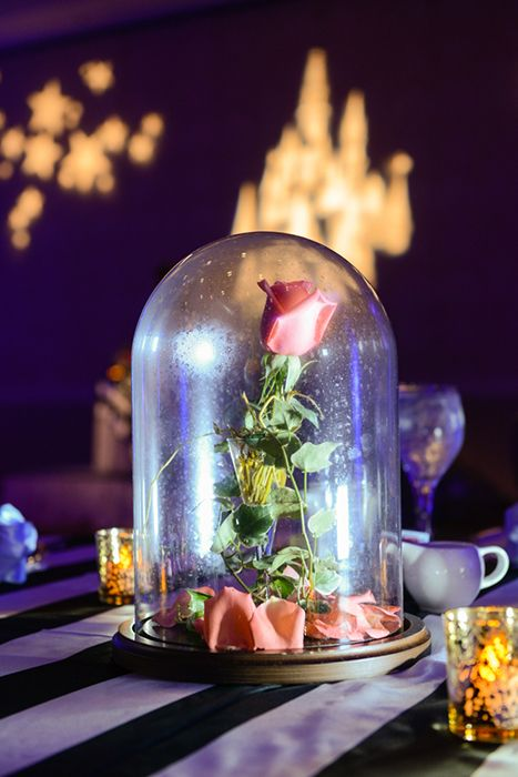 This glass dome rose centerpiece is perfect for a beauty
