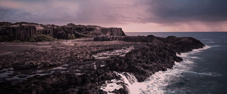 Waves crashing against rocks at Bombo Quarry near Kiama on the New South Wales South Coast on a stormy day.