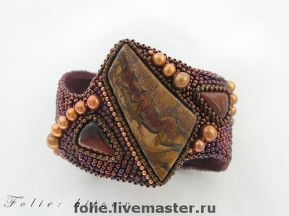 Spices. Perfect name for this gorgeous bead embroidered cuff via Massarova Victoria.. Loving the choice of colors, pearl accent beads and smaller cabs she used to compliment the gorgeous Australian Tiger's Eye focal.