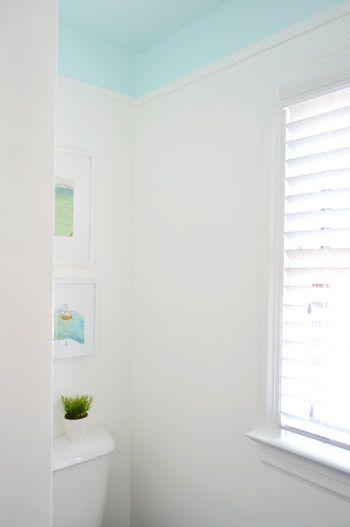 adding color and trim to a bathroom ceiling