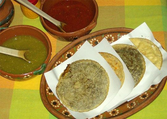 Mexican gorditas... a thicker tortilla opened and stuffed with various fillings, from mole to picadillo to huevo rojo and many more