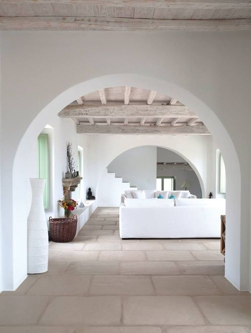 Minimal, white, but slightly rustic living area