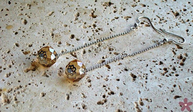 orecchini con mezzi cristalli