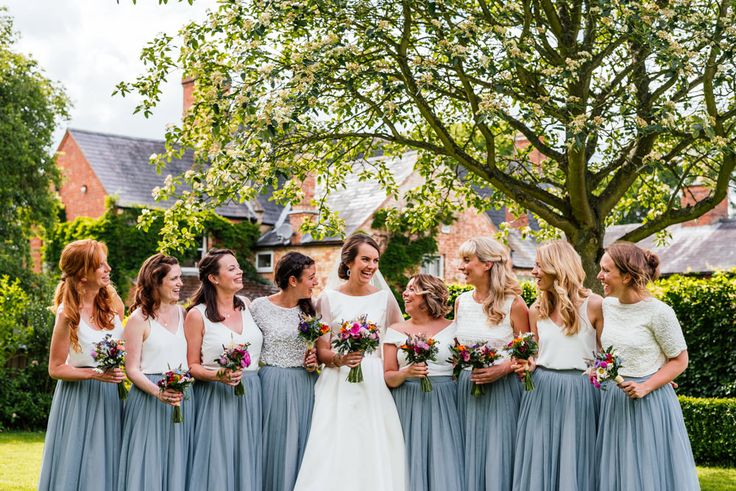 Bridesmaids in Blue Tulle Skirts - Pronovias Wedding Dress With Pockets For A Marquee Wedding At Home With Brightly Coloured Home Grown Flowers Images by Aaron Collett Photography