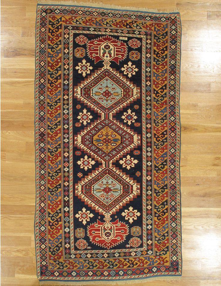 "Karagashli rug,Kuba District,Eastern Caucasus,dated 1291=1873 Christian date, 7'.4""x3'.9"" (224x114 cm)."