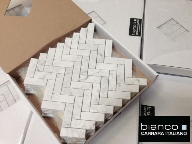 "$12.75 a square foot. Italian Carrara marble cut into 1x3"" Herringbone Mosaic Tile for the bathroom floor (SEE LEAVE IT TO BRYAN'S CUT IT OUT EPISODE)"
