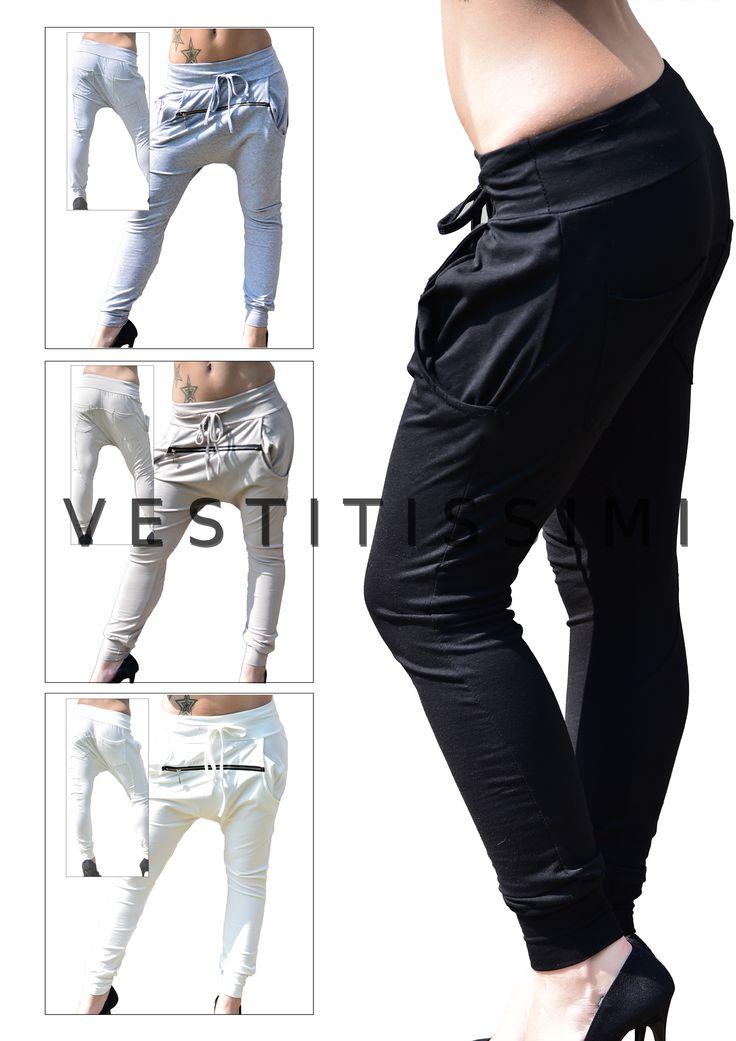 Pantaloni donna tuta fitness in vari colori con zip orizzontale, tasche e chiusura con lacci. Pantalone stile harem con cavallo basso. Pantaloni fitness tuta stile harem con cavallo basso.