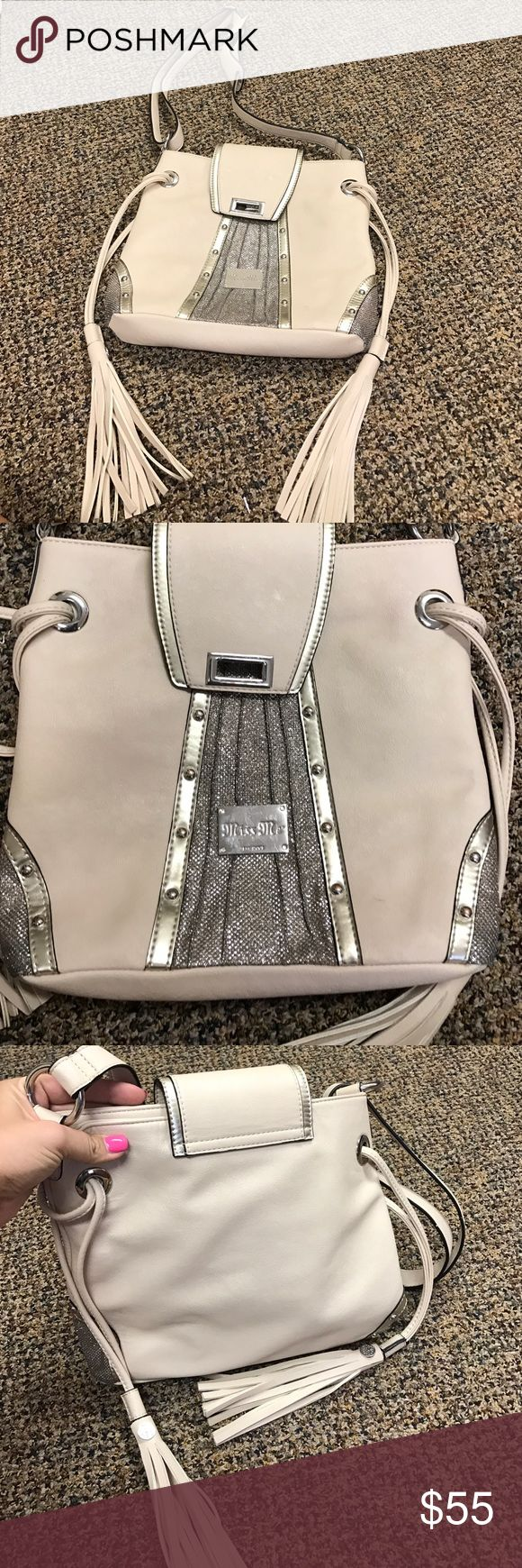 Beige Miss Me purse Brand new without tags never has been worn it was bought from the Buckle and is Miss Me brand, it has an adjustable strap and is in very good condition Miss Me Bags Crossbody Bags
