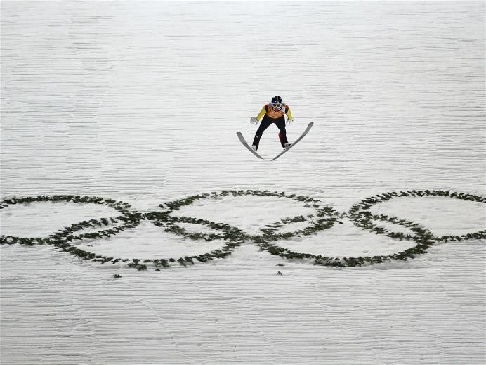 DAY 11:  Andreas Wellinger of Germany competes during the Ski Jumping Men's Team Large Hill