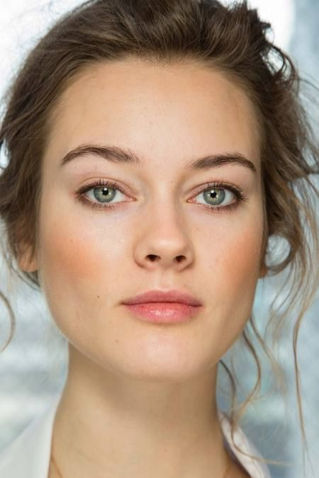 Beautiful soft makeup, brown eye pencil and bronzer.