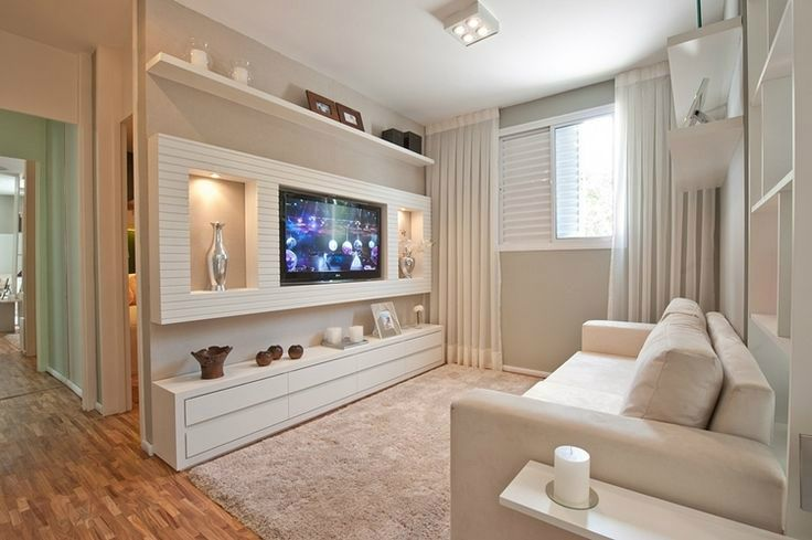A large horizontal sheet of wood with inset shelving adds visual interest while also hiding wires. The shelf below could hide other ugly bits like gaming consols and DVRs while providing an attractive space to feture decor.