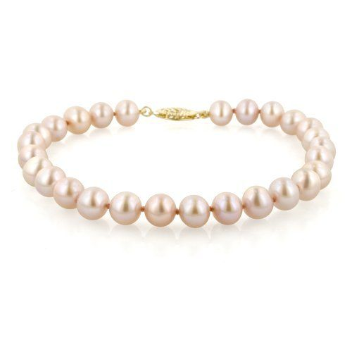 """14k Yellow Gold 6.5-7mm Pink Freshwater Cultured AA Quality Pearl Bracelet, 8"""" Amazon Curated Collection. $58.00. Pearls may have been treated to improve their appearance or durability and may require special care.. Made in China. Save 65% Off!"""