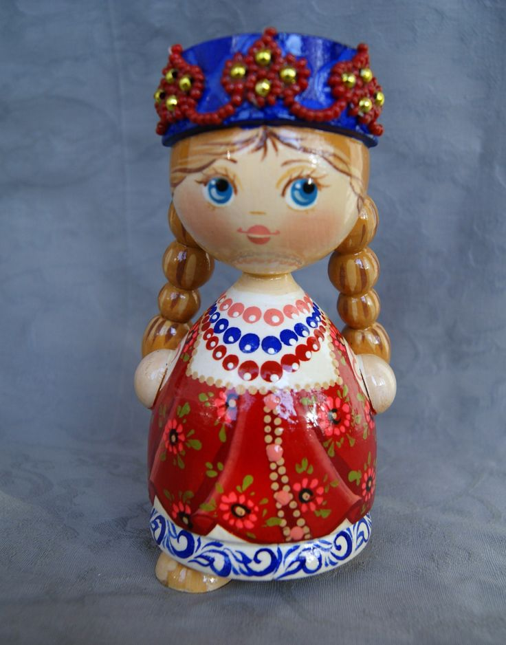 A wooden painted doll is one of the traditional Russian toys. #folk #art…