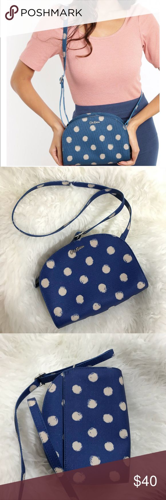 cath kidston • blue polka dot print sling bag condition: used once, like new  * purchased at Harrod's in London! * adjustable strap * main zip compartment, inner slip pocket, slip pocket on back * Coated canvas exterior, lined in cotton * Dimensions: 15 x 22 x 7.5 cm    NO TRADES  trusted seller for years • ships quickly great feedback • REASONABLE offers welcome Cath Kidston Bags