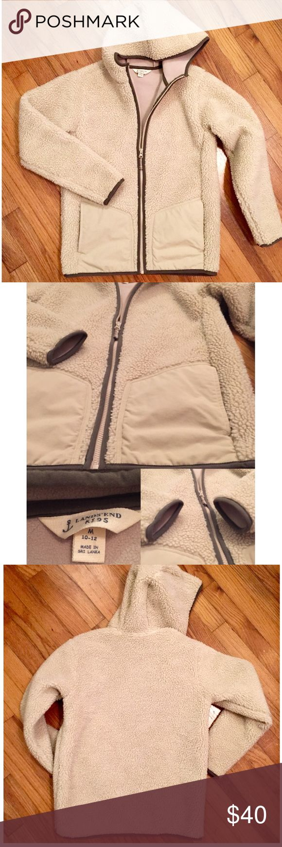 "🌟SALE🌟LANDS END KIDS Sherpa Fleece Zip Up Jacket **SALE PRICE FIRM UNLESS BUNDLED** This is a brand new (w/out tags) Sherpa winter jacket from Lands End Kids. Zips up, has hood, and pockets. Sold on their site as a boy's jacket but the colors are gender neutral; a cream/light tan color and brown trim. Tag size: 10 to 12. This is a good looking jacket! It's a great everyday/""wear with everything"" for your kiddo.😊 Thanks for looking!  ***BUNDLE 2 OR MORE ITEMS IN MY CLOSET AND SAVE AN…"