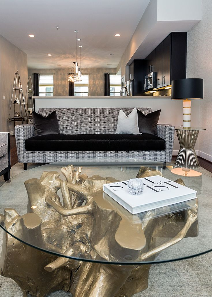 Black And White With Gold Accents In This Dramatic Living Room Glamorous Living Room Marble Tables Living Room Living Room Grey Gold accent living room decor