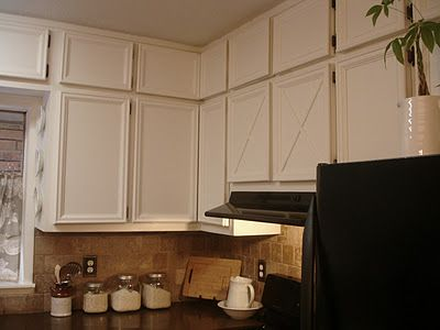 Turn plain flat cabinet fronts into designer looking cabinets with molding! Love this idea!