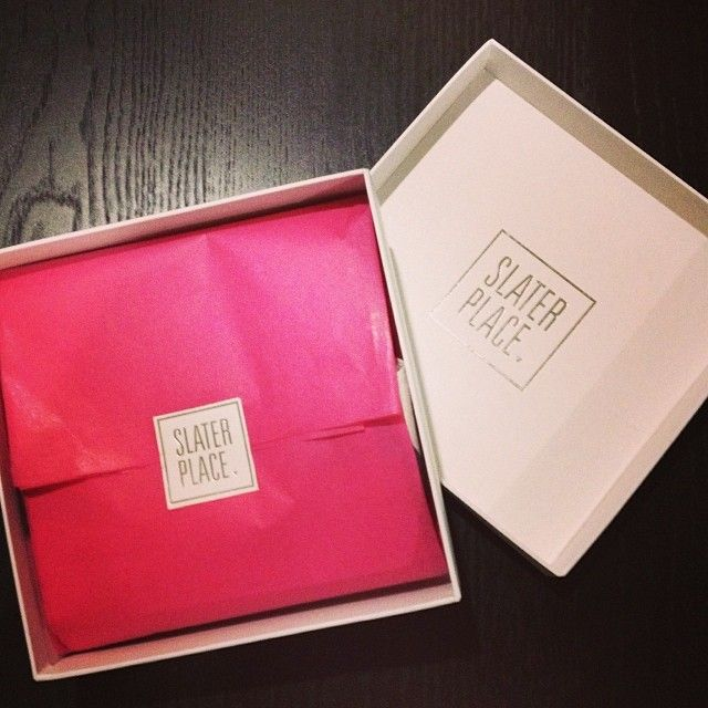 A Slater Place scarf tucked in to one of our new white logo boxes.   #slaterplace #packaging #branding #pink