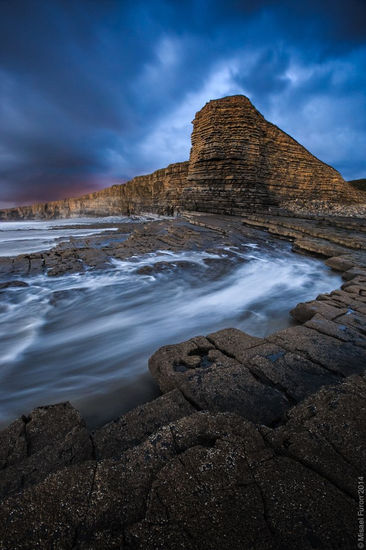 Nash Point is a headland and beach in the Monknash Coast of the Vale of Glamorgan in south Wales, UK. It is a popular location for ramblers and hiking along the cliffs to Llantwit Major beach. - by Misael Furon