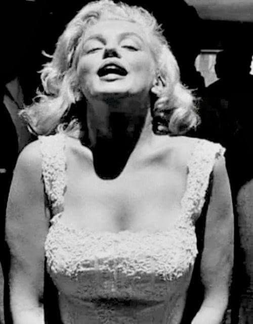 Rare shot of Marilyn Monroe at the opening of the Time/Life building in NYC, July 1957 <3