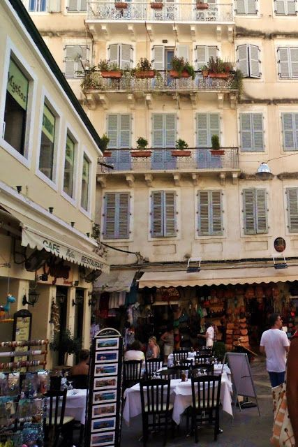 Little shops and tavernas on the colorful Greek streets from Kerkyra, Corfu